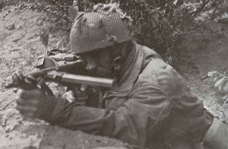 British paratrooper using his Sten gun Mark 5