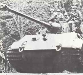 King Tiger tank with infantry at the Battle of the Bulge