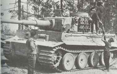 Replenishing ammunition of a PzKpfw VI Ausf.E .