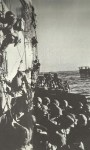 US soldiers climb into their landing crafts in Lingayen Gulf
