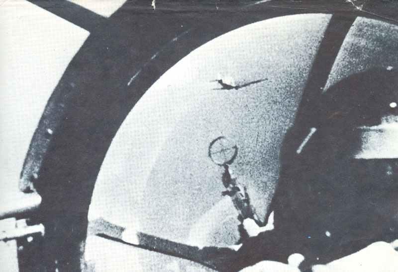 gunner of bomber fires on Spitfire