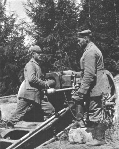 German artillerymen prepare to fire a howitzer