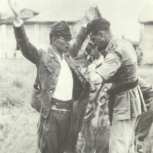 British officer searches a Japanese