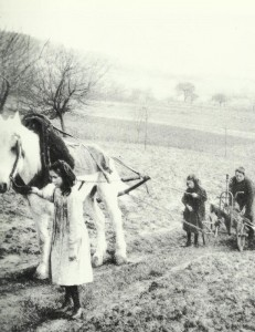 Women and children  plowing