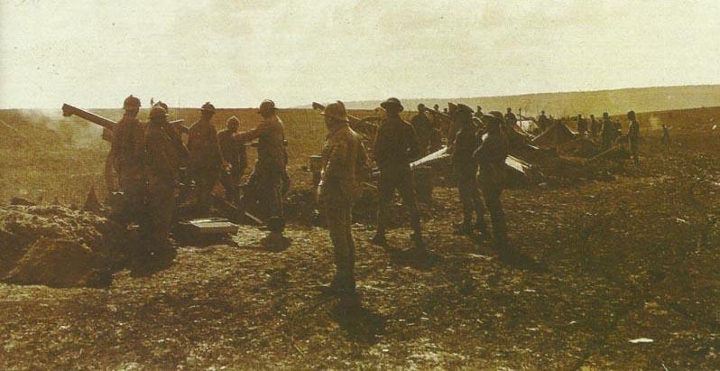 French battery firing their 75-mm mle 1897 field guns