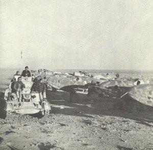British tank passes destroyed Italian planes.