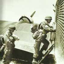 Paratroopers enter a Ju 52.
