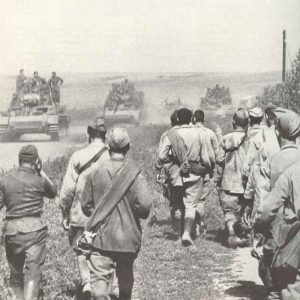 German tanks advancing, Russian PoWs flow back
