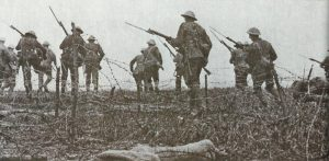 British infantry attacking through barbed wire
