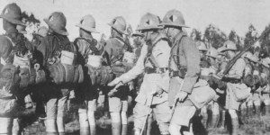 Two officers inspect South African infantry