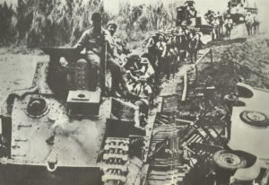Japanese light tanks cross a provisional bridge