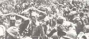 US prisoners pass their captors on Corregidor.