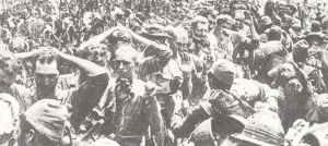 US prisoners pass their captors on Corregidor.
