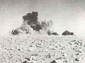 British armoured cars under bomb attack by Stukas.