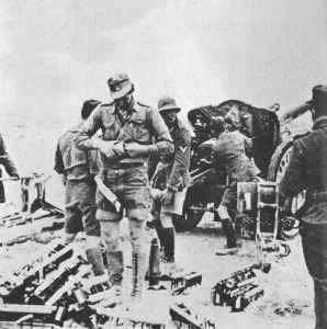 German 105mm leFH18 field gun is shelling British positions