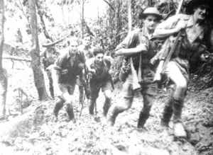 Australian soldiers of the 39th Battalion marching on the Kokoda Trail