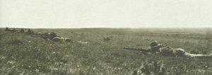 Dismounted Australian mounted infantrymen open fire