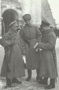 Russian soldiers reading  propganda leaflets