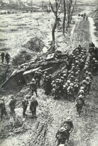 British soldiers gather at a plug-in tank.