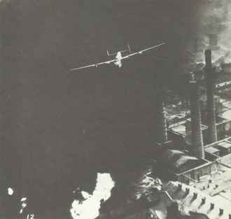B-24 Liberator at roof height over the Ploesti Oilfields.
