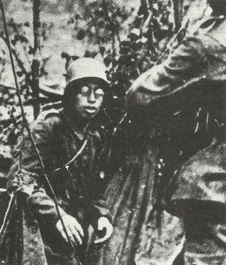 Bespectacled German soldier surrenders