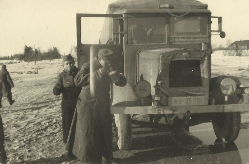 Soldiers of the 214th Infantry Division with truck