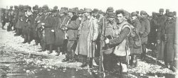 British soldier guards a group of Austro-Hungarian PoWs