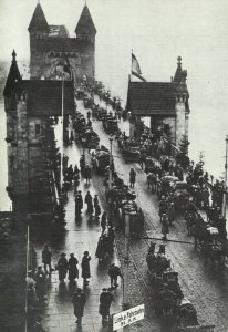 Return of German troops over the Rhine bridge near Bonn.