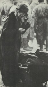 old woman with the rest of her belongings after air raid