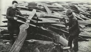 Wooden propellers of German airplanes are dismantled
