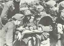 Hungarian officers confer with a German