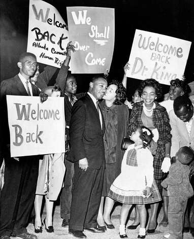 Dr. Martin Luther King is given a welcome home kiss by his wife Coretta, upon his return to Atlanta following his release from Reidsville State Prison on bond, on October 27, 1960. King's children, Yolanda, 5, and Martin Luther III, 3, join the welcome celebration. (AP Photo) / Beaumont
