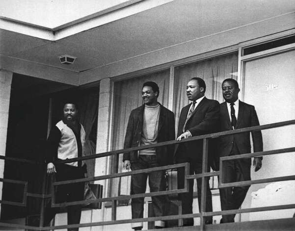The Rev. Martin Luther King Jr. stands with other civil rights leaders on the balcony of the Lorraine Motel in Memphis, Tenn., on April 3, 1968, a day before he was assassinated at approximately the same place. From left are Hosea Williams, Jesse Jackson, King, and Ralph Abernathy. The 39-year-old Nobel Laureate was the proponent of non-violence in the 1960's American civil rights movement. King is honored with a national U.S. holiday celebrated in January.    (AP Photo) / Beaumont
