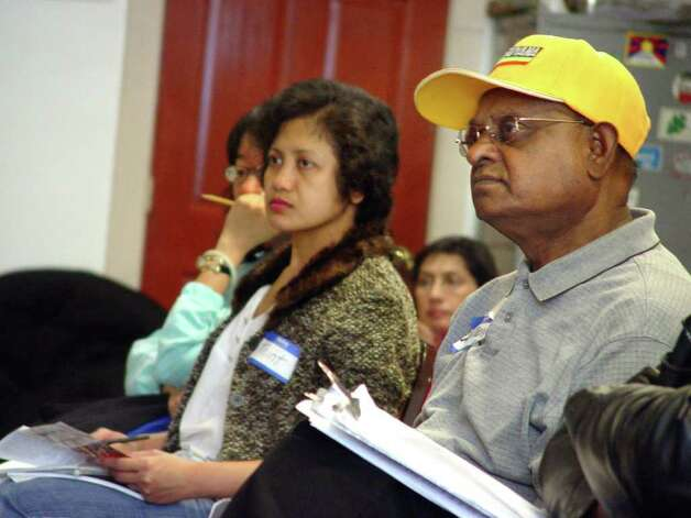 Among the 21 students taking medical interpreter training in Albany are Thint Thint Htoo of Rensselaer, right, who speaks Burmese, and Schenectady resident Bharath Arjoon, left, who is fluent in Guyanese. (Courtesy St. Peter?s Hospital) / AL