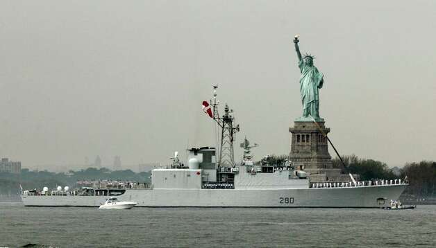 The HMCS Iroquois, from Canada, sails by the Statue Of Liberty, in New York, to participate in Fleet Week activities, Wednesday. (AP Photo/Richard Drew) Photo: Associated Press / SL