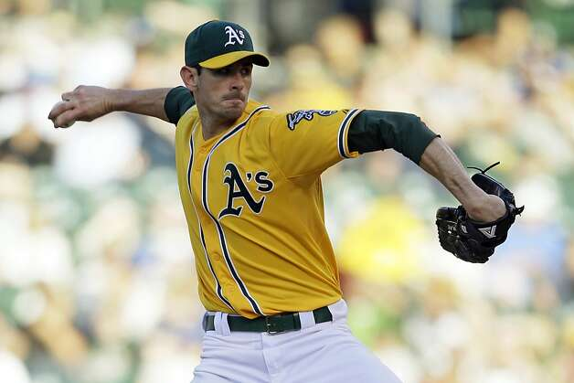 Oakland Athletics starting pitcher Brandon McCarthy throws against the Los Angeles Dodgers during the first inning of their baseball game in Oakland, Calif., Tuesday, June 19, 2012. (AP Photo/Eric Risberg) Photo: Eric Risberg, Associated Press
