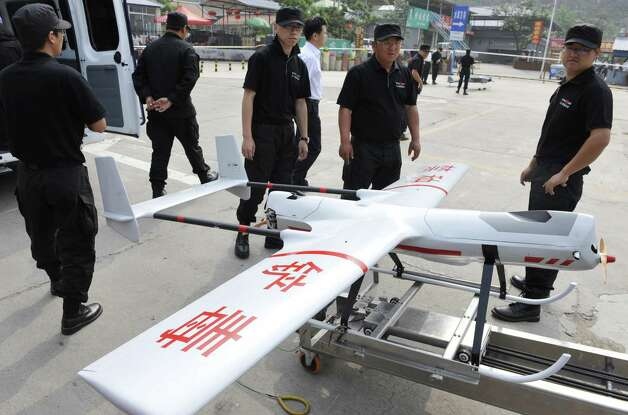 "Chinese police unveiled its ""first unmanned opium reconnaissance plane"" in Beijing on June 4, 2010. Photo: STR, AFP/Getty Images / 2010 AFP"