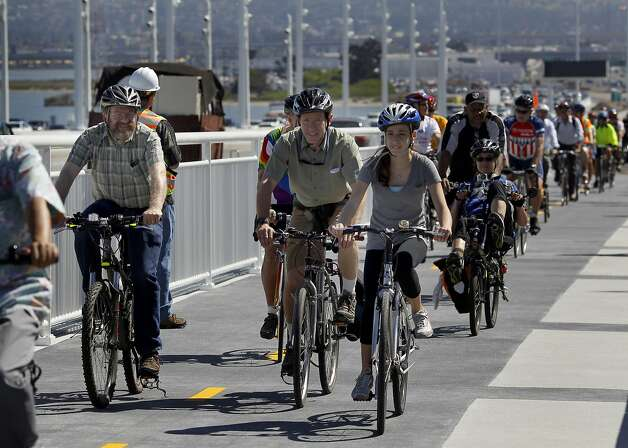 Members of the Alex Zuckermann family (center) were some of the first to make the ride on the path named after their father and grandfather Tuesday, September 3, 2013. The Alexander Zuckermann bicycle and pedestrian path on the new eastern span of the Oakland Bay Bridge was opened Tuesday. Photo: Brant Ward, The Chronicle
