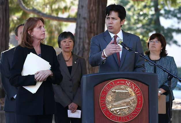 SANTA ROSA, CA - NOVEMBER 22:  California state senator Noreen Evans (D-Santa Rosa) (L) looks on as state senator Kevin de Leon (D-Los Angeles) speaks during a news conference on November 22, 2013 in Santa Rosa, California.  One month after 13 year-old Andy Lopez was shot and killed by a Sonoma County sheriff deputy as he held a replica of an AK-47 assault rifle, California state legisaltors announced plans to introduce legislation called the Imitation Firearm Safety Act which would regulate immitation firearms and require that toy guns be painted in bright colors.  (Photo by Justin Sullivan/Getty Images) Photo: Justin Sullivan, Getty Images