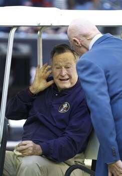 Former president George H.W. Bush chats with Houston Texans owner Bob McNair before an NFL football game at NRG Stadium, Sunday, Nov. 23, 2014, in Houston.  ( Karen Warren / Houston Chronicle  ) Photo: Karen Warren, Houston Chronicle