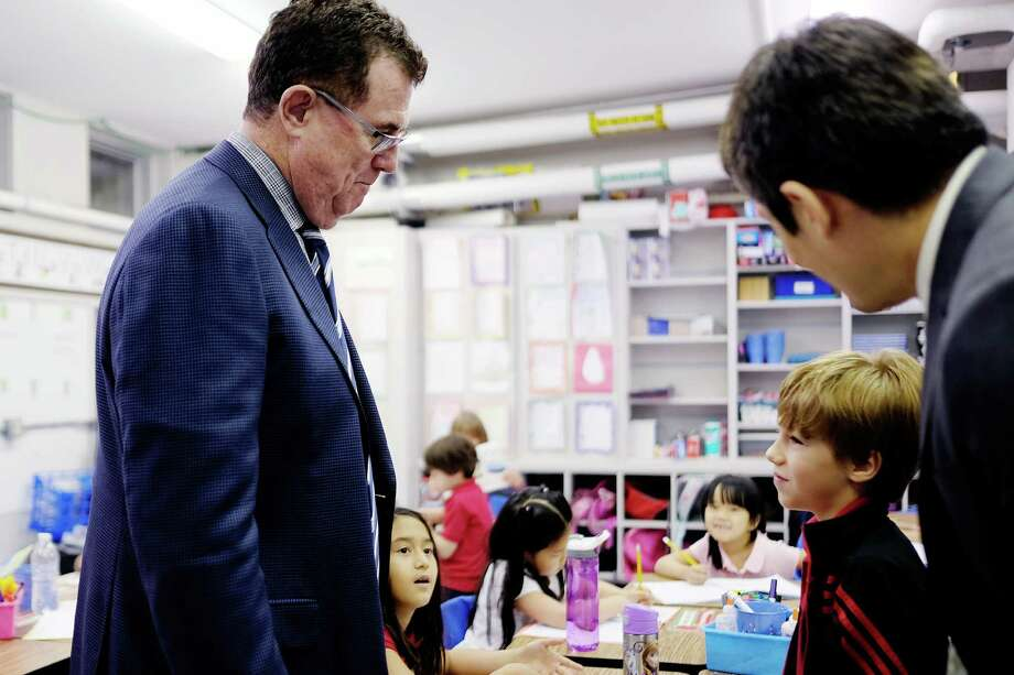 HISD Superintendent Terry Grier talked with a student during a May 2015 visit to the Mandarin Chinese Immersion School, one of the newest magnet schools in the district. Applications far exceeded available seats last year. Photo: Todd Spoth, For The Houston Chronicle / © TODD SPOTH PHOTOGRAPHY, LLC