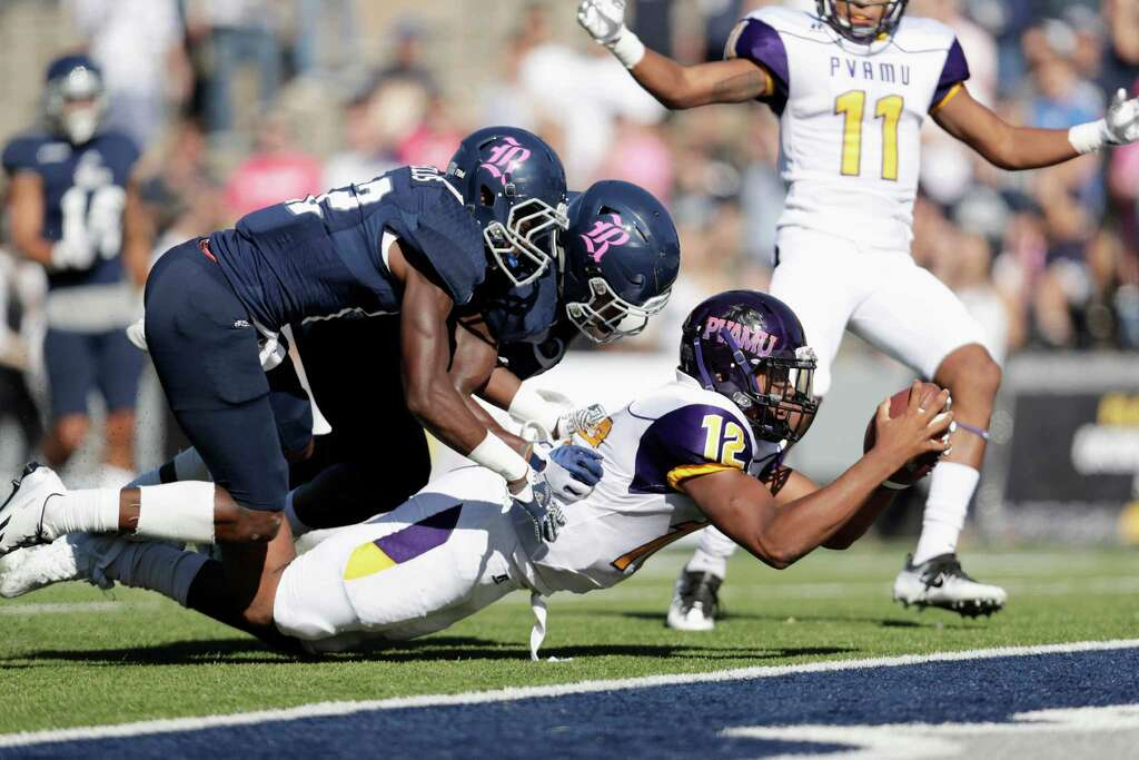Prairie View A&M Panthers quarterback Jalen Morton (12) dives over the goal line for a rushing touchdown in the second quarter as the Rice Owls defenders attempt to make the tackle during the NCAA football game between the Prairie View A&M Panthers and the Rice Owls at Rice Stadium in Houston, TX on Saturday, October 22, 2016.   The Owls lead the Panthers 45-14 at halftime. Photo: For The Chronicle / Houston Chronicle