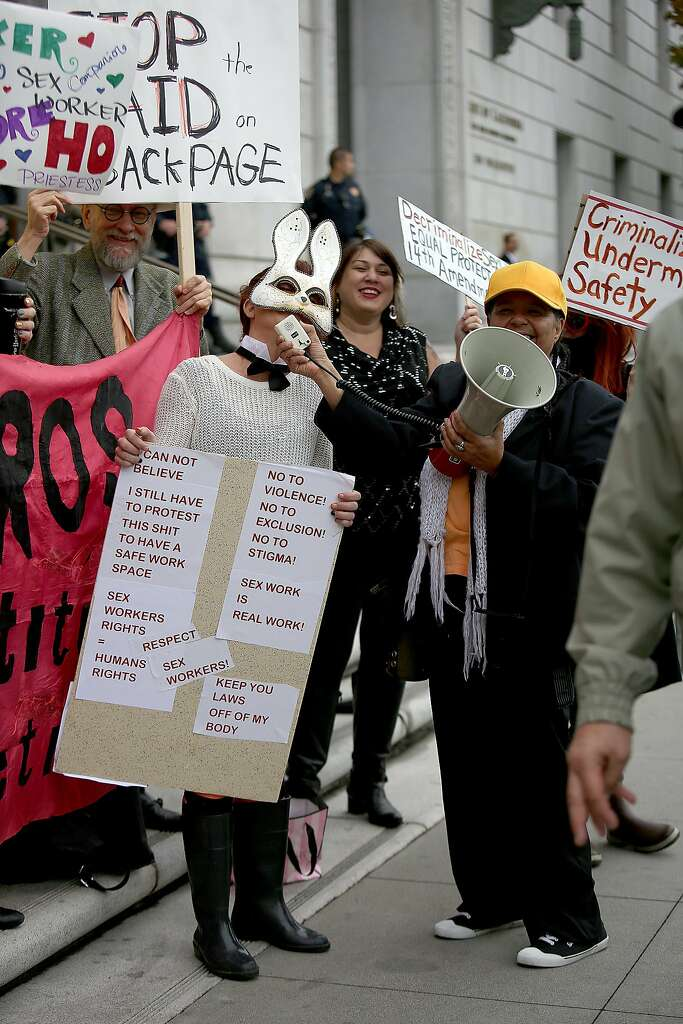 Happy Bunny (left) protests the raid on Backpage outside of the California Supreme Court on Tuesday, October 26, 2016, in San Francisco, Calif. Photo: Liz Hafalia, The Chronicle