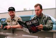 Law enforcement officer Paul Budrow, right, reads a copy of High Times magazine, as officer Wray Graham looks on, while waiting to be deployed to a marijuana patch near Ukiah, Calif., Tuesday Sept. 22, 1998. They read the magazine to keep up on the drug culture. Officers come from across the state to spend eight weeks with the multi-agency task force called CAMP - the Campaign Against Marijuana Planting.  In camouflage, they swoop onto hillsides from helicopters and use machetes to hack down hundreds of marijuana plants. (AP Photo/George Nikitin) Photo: GEORGE NIKITIN, Associated Press