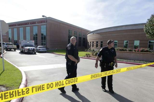 Officers respond to a shooting at North Cypress Medical Center  on Tuesday, Jan. 3, 2017, in Houston. The incident happened about 9.am. after a suspect walked into an emergency room, pulled out a gun and fired at least one shot into the air.  Deputies at the scene ordered the man to drop the weapon, but he refused.  One deputy opened fire on the man, wounding him. ( J. Patric Schneider / For the Chronicle )