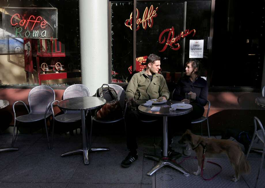 Stephen James and Brittany Quintero have lunch at Caffe Roma on Columbus Avenue in North Beach in 2013. Photo: Paul Chinn, The Chronicle