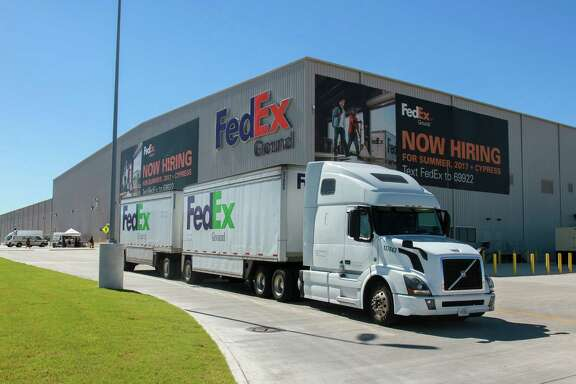 A FedEx truck leaving the new FedEx Ground 800,000-square-foot automated distribution hub in Houston.  (For the Chronicle/Gary Fountain, October 26, 2017