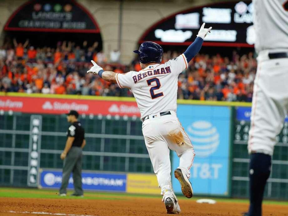 Image result for alex bregman rbi single World Series game 5
