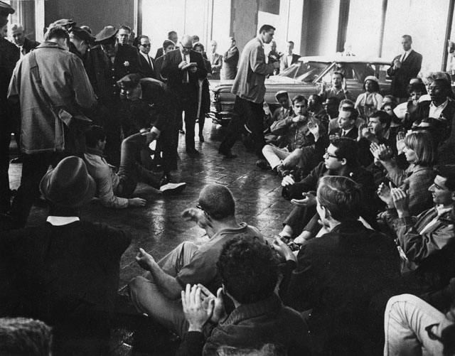 1964 sit-in at a Cadillac dealer in San Francisco; Photo by Jeffrey Blankfort