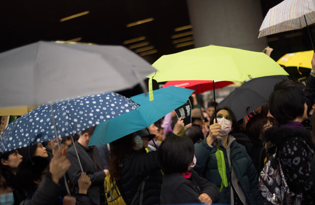 Protestors shout slogans during a march to the movement's main pro-democracy protest site in the Admiralty district of Hong Kong on December 5, 2014; Photo by Johannes Eisele/AFP/Getty Images